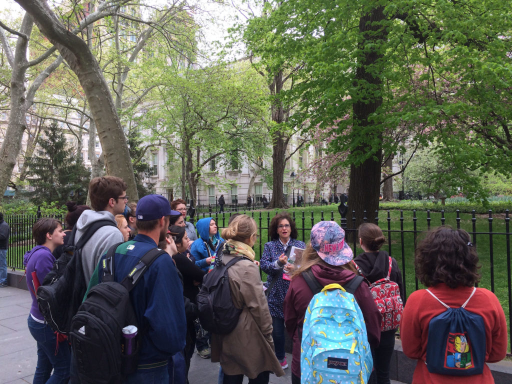 students gathered around a walking tour guide