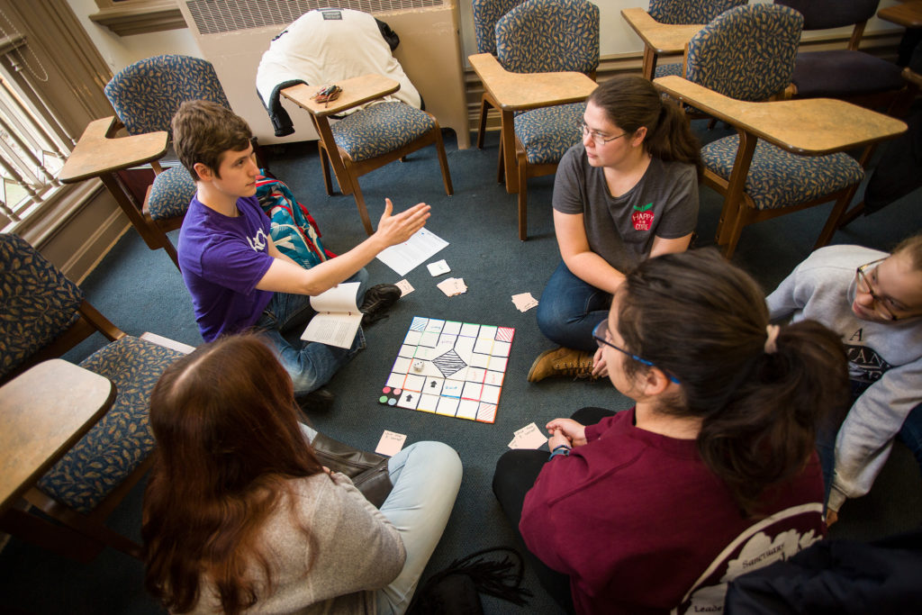 Students playing a board game that was a final project in one of my classes.