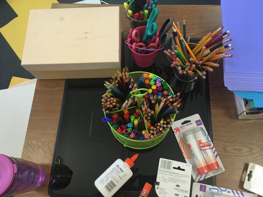 colored pencils, pens, and glue sticks