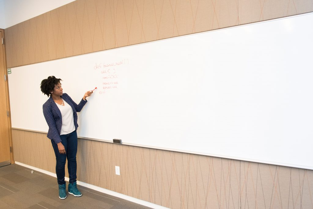 Woman at whiteboard